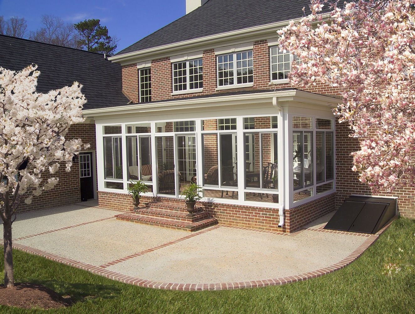 Enclosed Porchoutside View Many People Use Sunrooms To ... on Patio Enclosure Ideas  id=61833